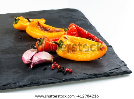 Red and yellow peppers grilled on olive oil