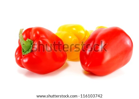 red and yellow peppers on a white background