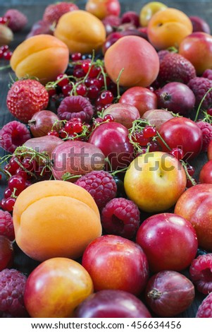 Red and yellow summer berries and fruits background