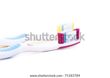 red and yellow toothbrushes isolated on white background