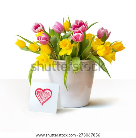 Red and yellow tulips bouquet with a heart card in front isolated on white background - stock photo