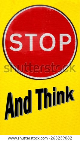 Red and yellow warning sign with a Stop And Think concept  - stock photo