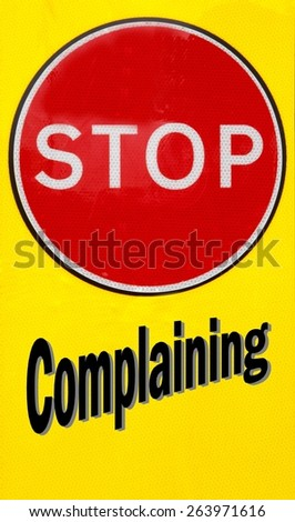 Red and yellow warning sign with a Stop Complaining concept