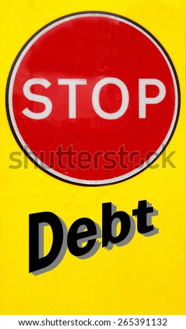 Red and yellow warning sign with a Stop Debt concept - stock photo