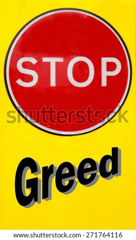 Red and yellow warning sign with a Stop Greed concept - stock photo