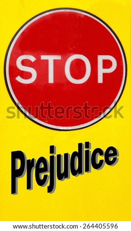 Red and yellow warning sign with a Stop Prejudice concept - stock photo