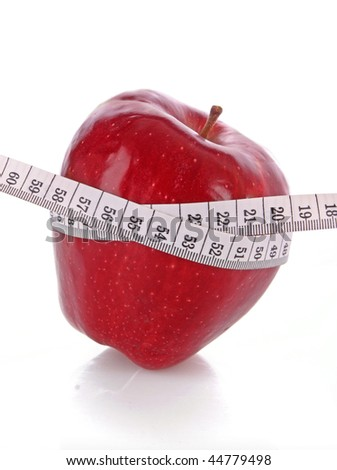 Red apple and a measure tape, diet concept - stock photo