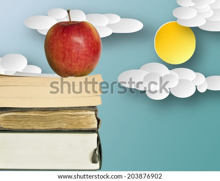 red apple and books on illustrated background  - stock photo