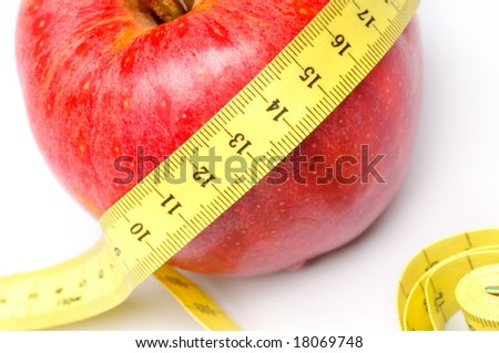 red apple and centimeter against white background