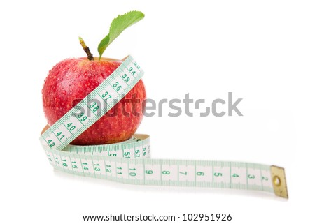Red apple and measuring tape on a white background. - stock photo