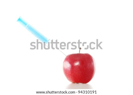 Red apple and syringes - stock photo
