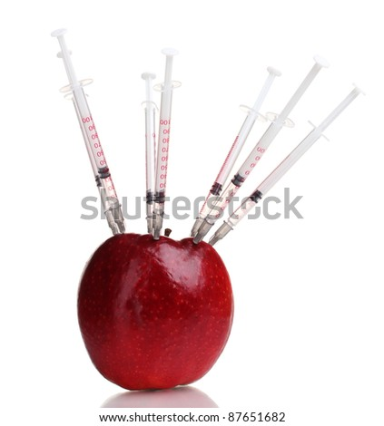 red apple and syringes isolated on white - stock photo