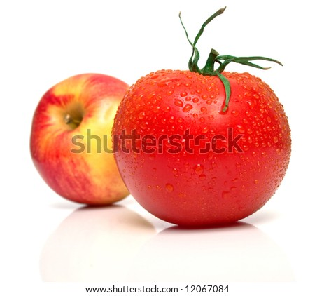 Red apple and tomato. Shallow DOF. Focus on a red tomato.