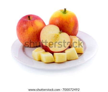 red apple in white plate isolated on white background