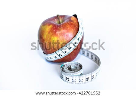 red apple measured with a yardstick white background