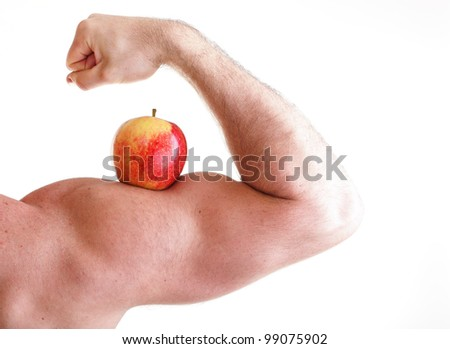 Red Apple on Man's Bicep Muscle isolated on white