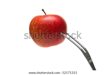 Red apple on the fork on white background
