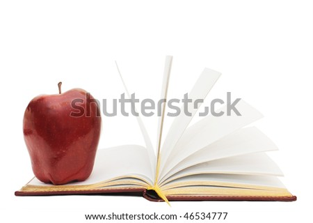 Red apple on the open book