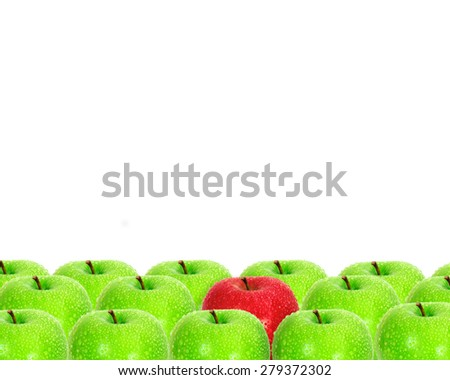 red apple place on white background among green apple with water droplet as frame border , unique or different concept - stock photo