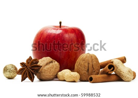 red apple, star anise, cinnamon sticks and some nuts  on white background - stock photo