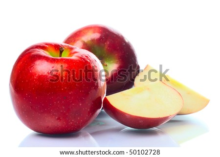 Red apple with a slice on a white background - stock photo