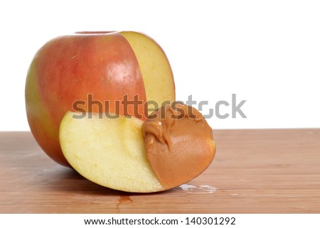 red apple with cut slice and peanut butter - stock photo