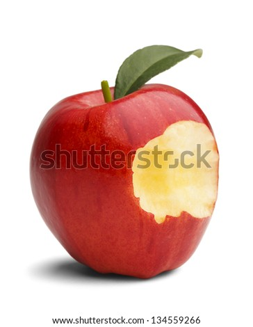 Red apple with green leaf missing a bite isolated on a white background. - stock photo