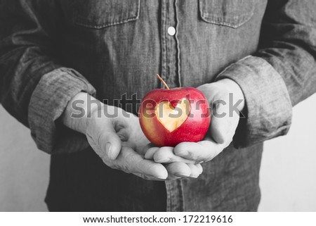 red apple with hands of man - stock photo