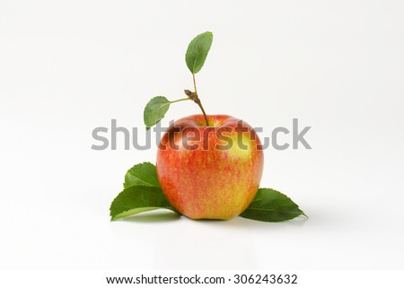 red apple with leaves on white background - stock photo