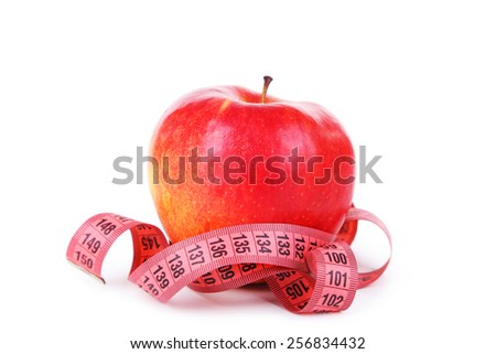 Red apple with measuring tape isolated on white