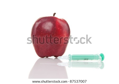 red apple with syringe isolated on white background
