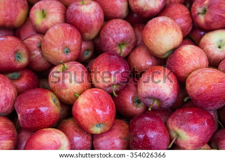 Red apples background at departmental store - stock photo
