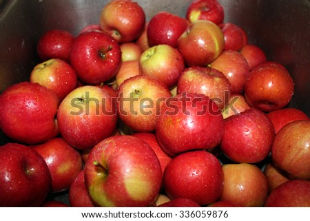Red Apples in a Sink Basin - stock photo