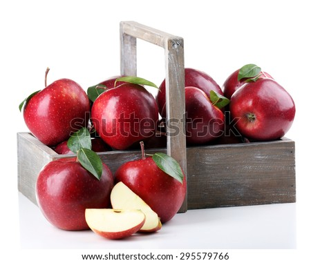 Red apples in wooden crate isolate on white - stock photo
