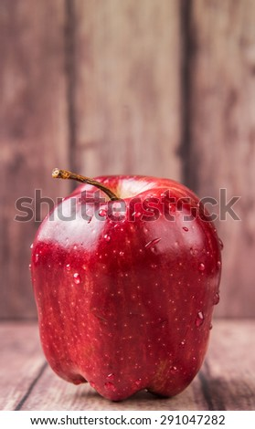 Red apples on weathered wooden background