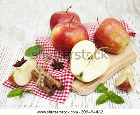Red apples  with mint  on a old wooden table