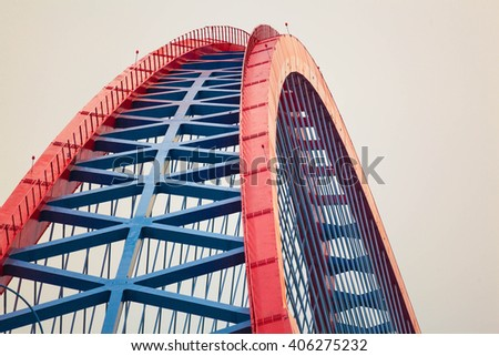 red arch of bridge close-up - stock photo