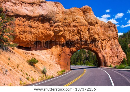 Red Arch road tunnel on the way to Bryce Canyon National Park,Utah,USA - stock photo