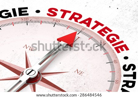 "Red arrow on a compass pointing to german word ""Strategie"" (strategy) (3D Rendering)"