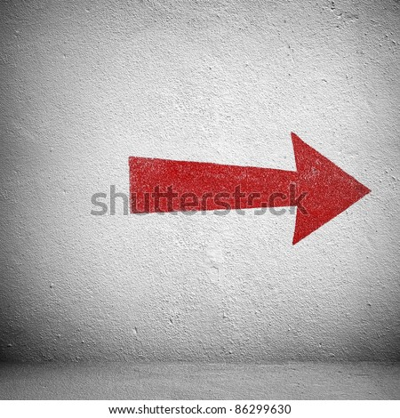 red arrow on white wall - stock photo