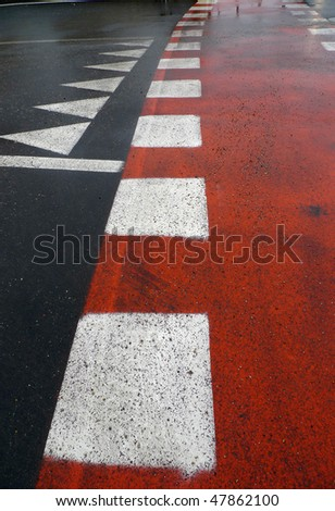 Red asphalt and white stripes  walking in cities