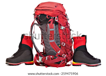 Red Backpack and Boots for Mountaineering. Studio shoot isolated on white background. - stock photo