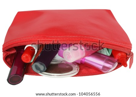 Red bag for cosmetics with a make-up accessories.