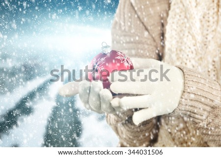 red ball and woman hands  - stock photo