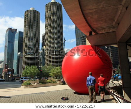 Red Ball comes to downtown Chicago, with Marina City in the background - stock photo