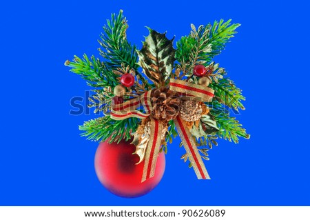 red ball, cone spruce, fir and sprigs to decorate for Christmas against a blue background - stock photo