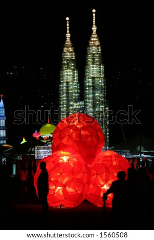 Red ball lantern with twin tower lanterns in the background