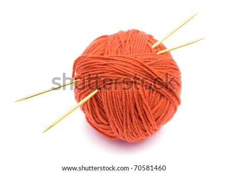 Red ball of wool and knitting needles isolated on white background