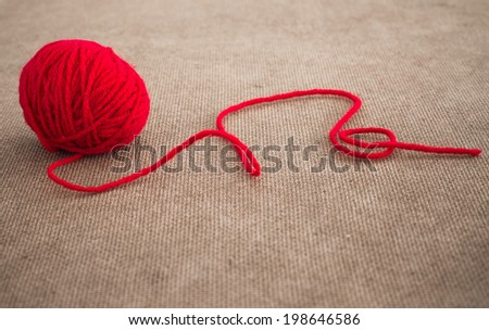 Red ball of yarn for knitting - stock photo