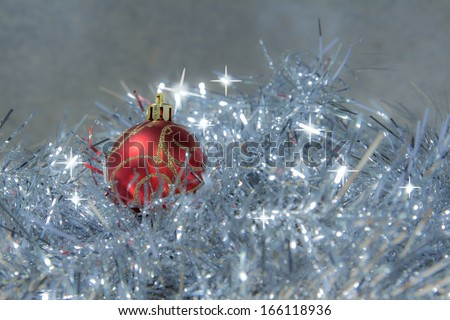 Red ball ornament on wooden board